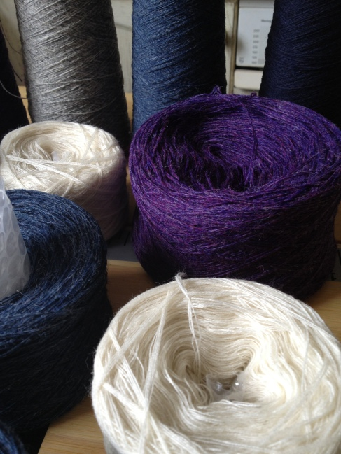 Shetland yarn cakes and cones, close up