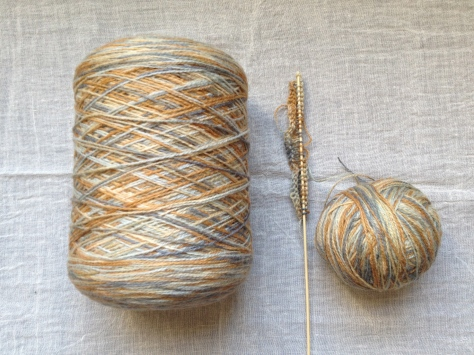 wool in shades of browns, greys, beige and gold yellow