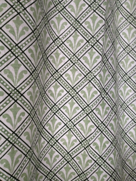 The curtains are made of Jonelle pure cotton, in green/cream with a leafy motif.